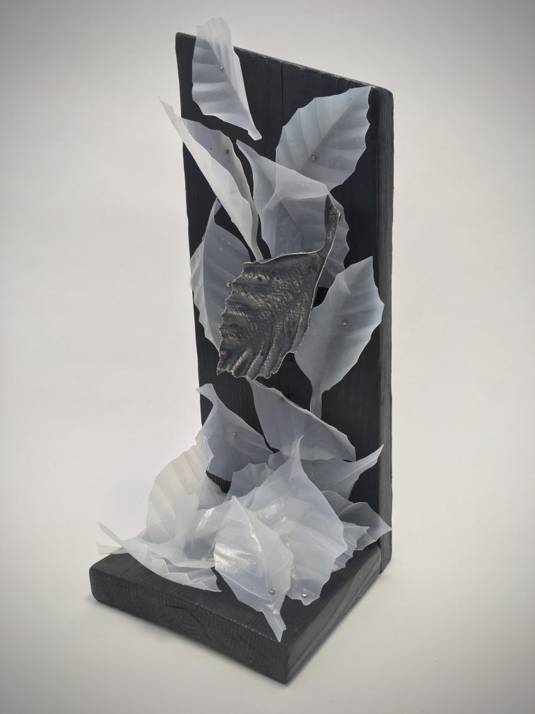 In our Hands 4, Leaf Brooch, oxidised recycled sterling silver,  plastic milk carton, steel pins, wood off-cuts. Height 27cm